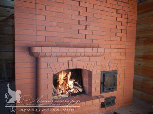 Банная печь периодического действия с открытым камином